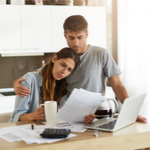 couple looking at financial papers