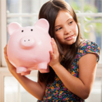 girl holding her piggy bank